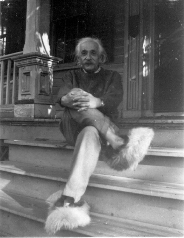 Albert Einstein wearing fuzzy shoes