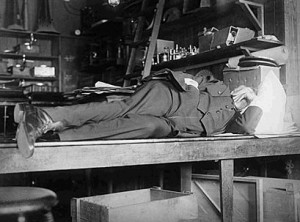 Thomas Edison taking a nap in laboratory