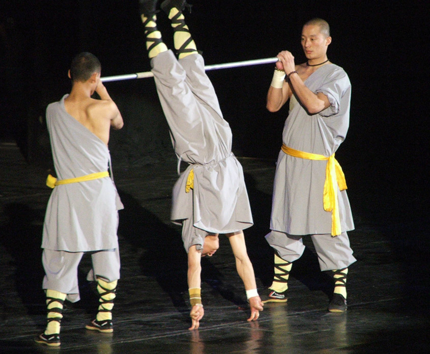 Shaolin monk standing in fingers
