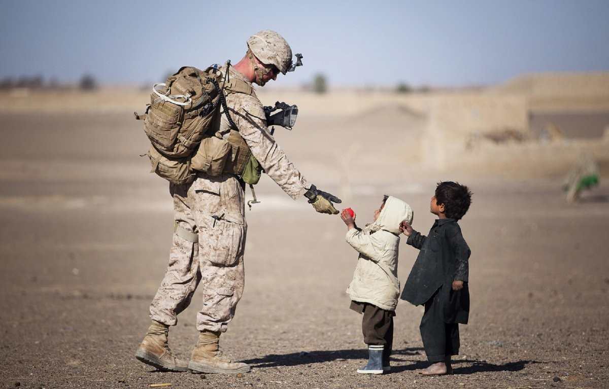 Soldier and children