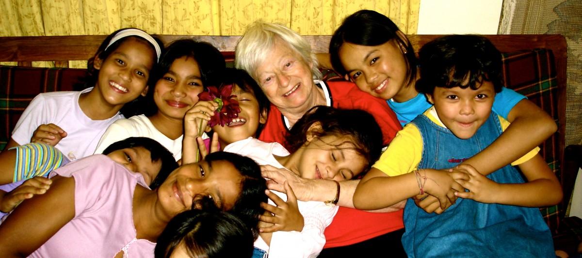 Olga Murray with children