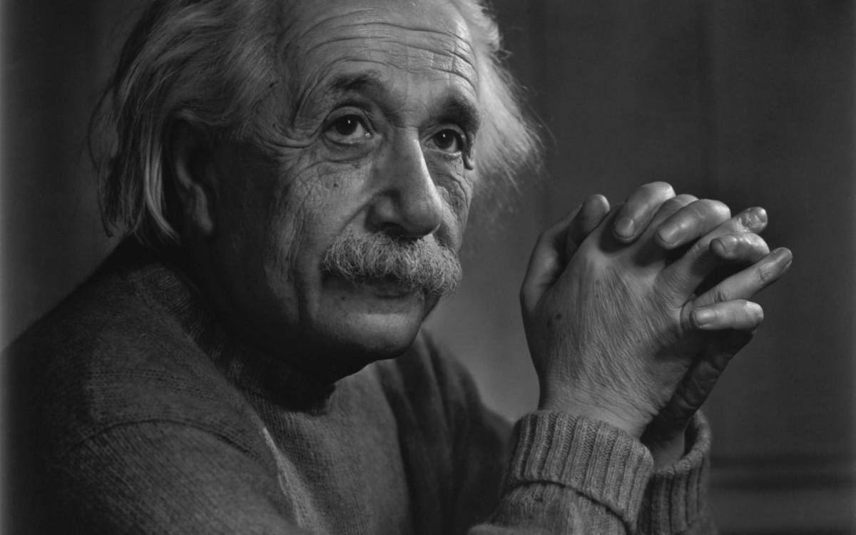 Albert Einstein keeping his fingers crossed