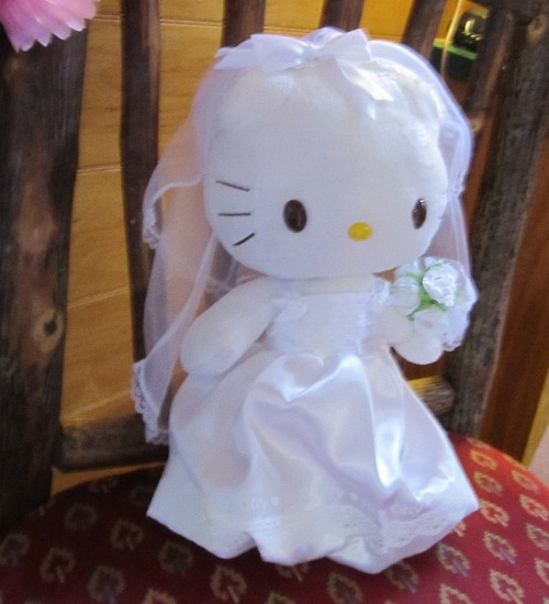 Hello Kitty wearing a wedding dress