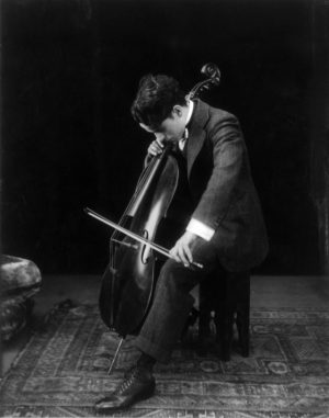 Charlie Chaplin playing the cello in 1915